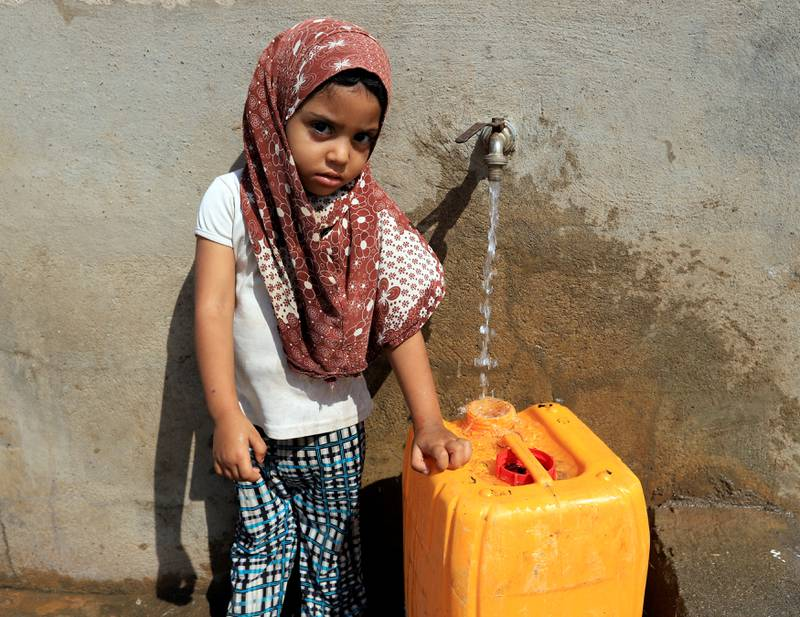 A girl fills a jerry can with drinking water on Salam Street in north Hodeidah, Yemen March 25, 2019. REUTERS/Abduljabbar Zeyad