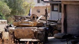 Syrian soldiers eye Turkish outpost in recaptured town