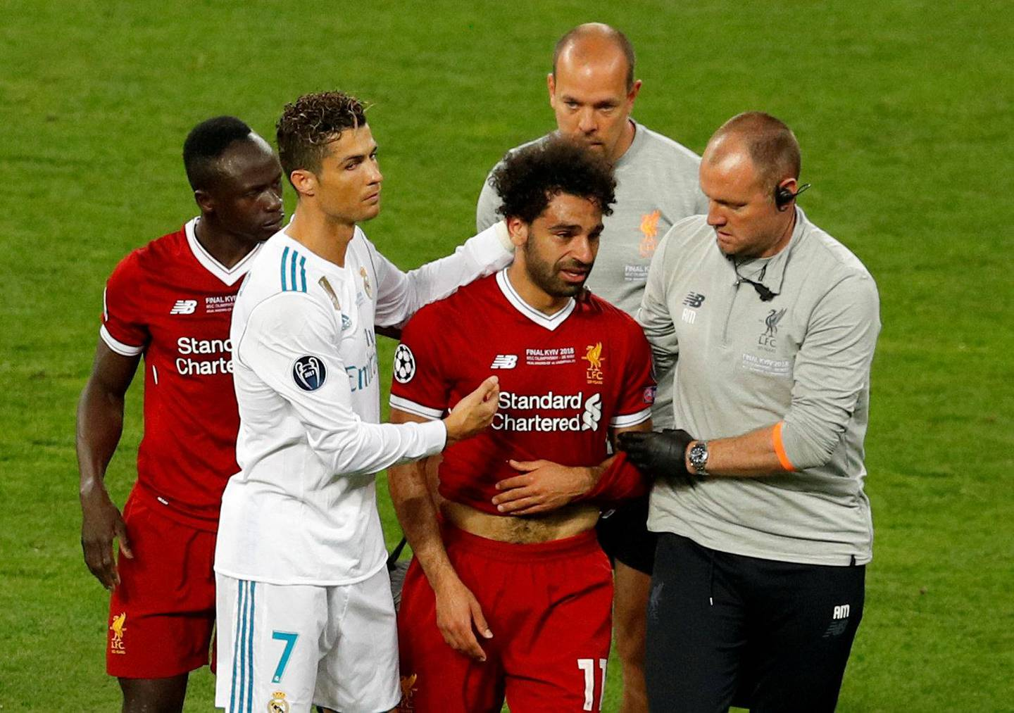 FILE PHOTO: Soccer Football - Champions League Final - Real Madrid v Liverpool - NSC Olympic Stadium, Kiev, Ukraine - May 26, 2018   Liverpool's Mohamed Salah with Sadio Mane and Real Madrid's Cristiano Ronaldo as he is substituted after sustaining an injury   REUTERS/Phil Noble/File Photo