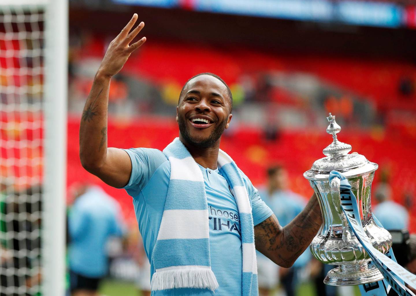 Soccer Football - FA Cup Final - Manchester City v Watford - Wembley Stadium, London, Britain - May 18, 2019  Manchester City's Raheem Sterling celebrates with the trophy after winning the FA Cup  Action Images via Reuters/John Sibley