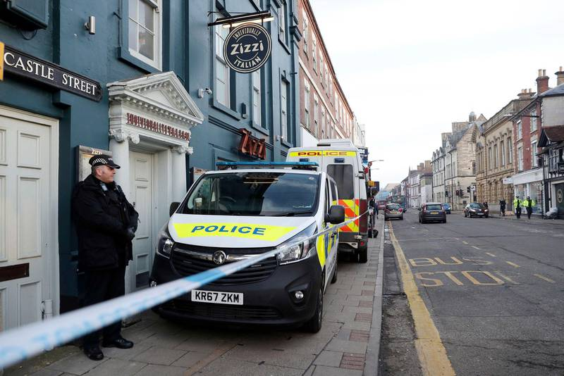 """A policeman stands outside the Zizzi restaurant in Salisbury, England Wednesday, March 7, 2018 near to where former Russian double agent Sergei Skripal was found critically ill. Britain's counterterrorism police took over an investigation Tuesday into the mysterious collapse of a former spy and his daughter, now fighting for their lives. The government pledged a """"robust"""" response if suspicions of Russian state involvement are proven. Sergei Skripal and his daughter are in a critical condition after collapsing in the English city of Salisbury on Sunday. (Andrew Matthews/PA via AP)"""
