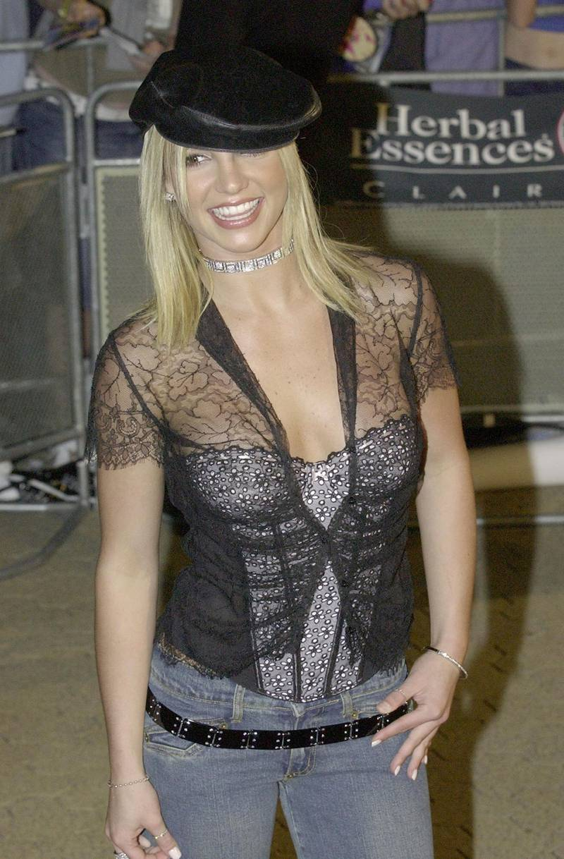 """APR 2002 - BRITNEY SPEARS   AT THE PREMIERE OF BRITNEY- SPEARS FIRST MOVIE """"CROSSROADS""""  AT FOX STUDIO, SYDNEY, AUSTRALIA. (Photo by Patrick Riviere/Getty Images)"""