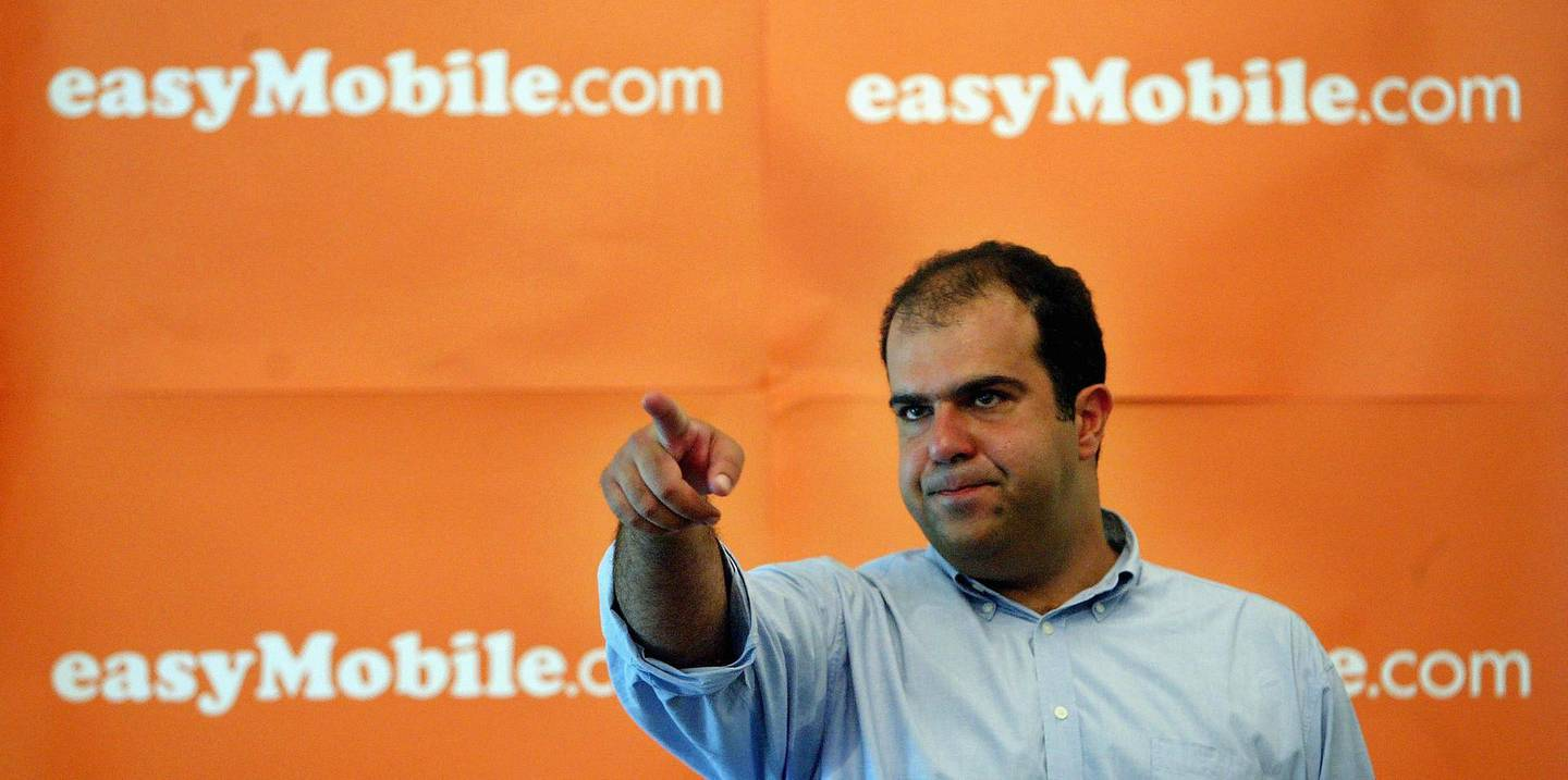 LONDON - AUGUST 10:  Easygroup founder Stelios Haji-Ioannou hosts a press conference announcing the launch of Easymobile.com at the Foreign Press Association on August 10, 2004 in London.  The new arm of the low-budget company will provide sim cards to consumers with economical tariffs for use in unlocked mobile phones. (Photo by Bruno Vincent/Getty Images)