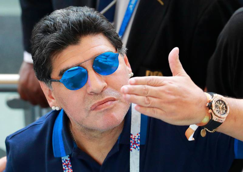 epa06852651 Argentinian soccer legend Diego Maradona gestures after the FIFA World Cup 2018 round of 16 soccer match between France and Argentina in Kazan, Russia, 30 June 2018. France won 4-3.  (RESTRICTIONS APPLY: Editorial Use Only, not used in association with any commercial entity - Images must not be used in any form of alert service or push service of any kind including via mobile alert services, downloads to mobile devices or MMS messaging - Images must appear as still images and must not emulate match action video footage - No alteration is made to, and no text or image is superimposed over, any published image which: (a) intentionally obscures or removes a sponsor identification image; or (b) adds or overlays the commercial identification of any third party which is not officially associated with the FIFA World Cup)  EPA/ROBERT GHEMENT   EDITORIAL USE ONLY