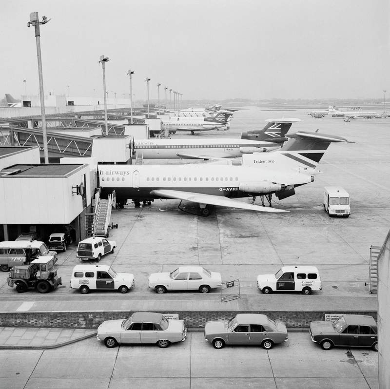 A Hawker Siddeley HS 121 Trident 2E registration G-AVFF and a Trident  3B registration G-AWZJ medium-range commercial  jet airliners for British European Airways  (BEA) lined up at their passenger terminal gates at London Heathrow airport on 1st May 1975 in London, United Kingdom.  (Photo by Fox Photos/Hulton Archive/Getty Images).