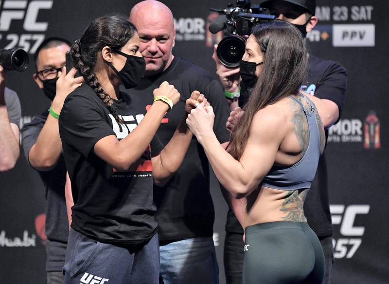ABU DHABI, UNITED ARAB EMIRATES - JANUARY 22: (L-R) Opponents Julianna Pena and Sara McMann face off during the UFC 257 weigh-in at Etihad Arena on UFC Fight Island on January 22, 2021 in Abu Dhabi, United Arab Emirates. (Photo by Jeff Bottari/Zuffa LLC) *** Local Caption *** ABU DHABI, UNITED ARAB EMIRATES - JANUARY 22: (L-R) Opponents Julianna Pena and Sara McMann face off during the UFC 257 weigh-in at Etihad Arena on UFC Fight Island on January 22, 2021 in Abu Dhabi, United Arab Emirates. (Photo by Jeff Bottari/Zuffa LLC)