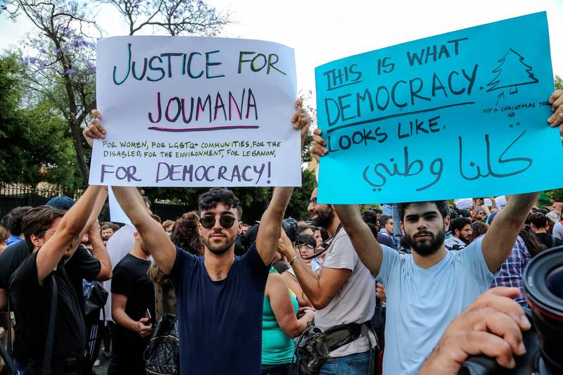 epa06717306 Supporters of Lebanese Joumana Haddad, a writer and a social activist who was running for a parliamentary seat in Beirut with the 'Kulluna Watani' list (We are all patriots), carry placards and shout slogans during a protest in front the interior ministry in Beirut, Lebanon, 07 May 2018. Candidate Jumana Haddad accuses the Interior Minister Nouhad Al-Mashnouq of falsifying the ballot box counting process. Unofficial counting a day earlier showed that Haddad won a seat in Beirut, the first such victory in the history of Lebanon. But the official results were announced with her losing.  EPA/NABIL MOUNZER