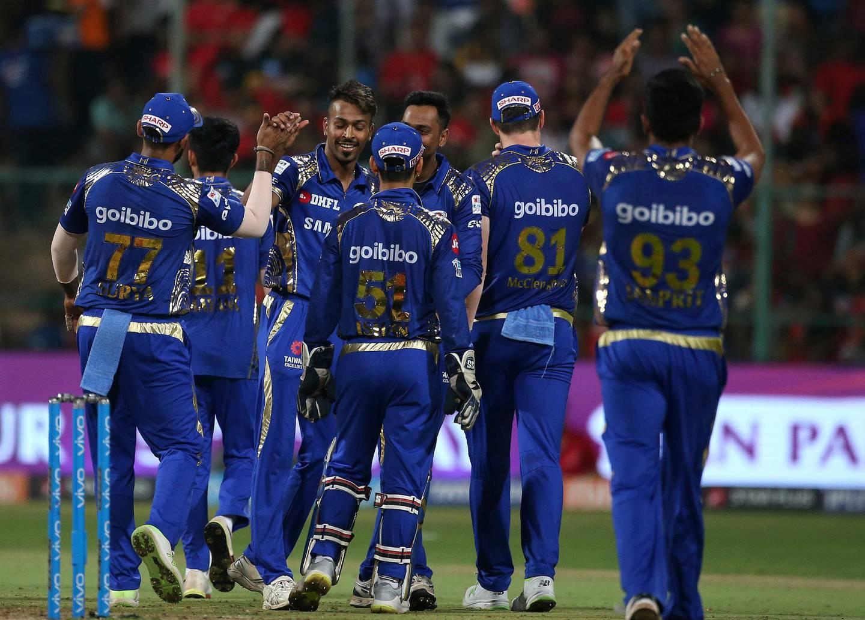 Mumbai Indians' Hardik Pandya, third left, celebrates with teammates the dismissal of Royal Challengers Bangalore's Washington Sundar during the VIVO IPL Twenty20 cricket match in Bangalore, India, Tuesday, May 1, 2018. (AP Photo/Aijaz Rahi)