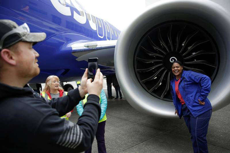 Boeing employee Tronja Nagra, quality insurance inspector for the 737 engine, poses in front of a 737 MAX 8 produced for Southwest Airlines as Boeing celebrates the 10,000th 737 to come off the production line in Renton, Washington, U.S. March 13, 2018.  REUTERS/Jason Redmond