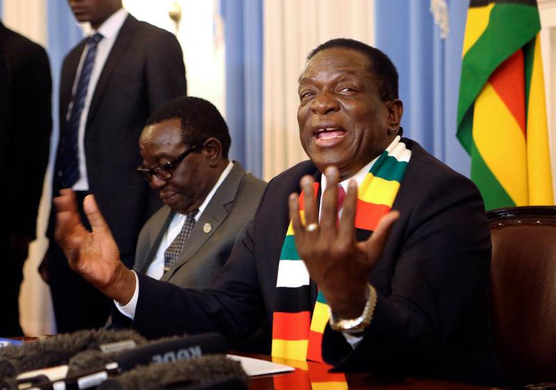 FILE - In this Friday, Aug. 3, 2018 file photo Zimbabwean President elect Emmerson Mnangagwa addresses a press conference in Harare. On Friday, Aug. 24, 2018 Zimbabwe's constitutional court upheld Mnangagwa's narrow victory in last month's historic election after the opposition alleged vote-rigging.  (AP Photo/Tsvangirayi Mukwazhi, File)