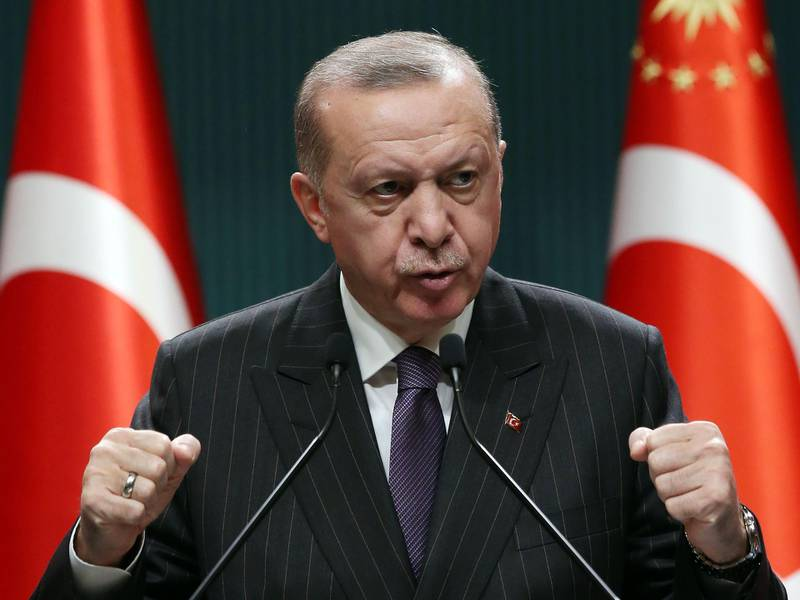 President of Turkey Recep Tayyip Erdogan makes a statement after chairing the cabinet meeting in Ankara, on December 14, 2020. / AFP / Adem ALTAN