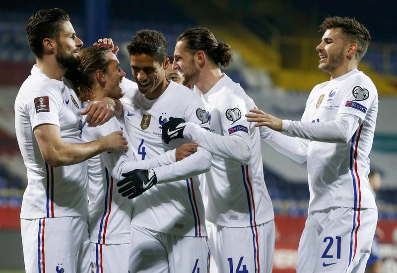 epa09109469 Antoine Griezmann (2-L) of France celebrates with teammate Olivier Giroud(L) and Raphael Varane (3-L) after scoring the opening goal during the FIFA World Cup 2022 qualifying soccer match between Bosnia & Herzegovina and France in Sarajevo, Bosnia and Herzegovina, 31 March 2021.  EPA/Fehim Demir