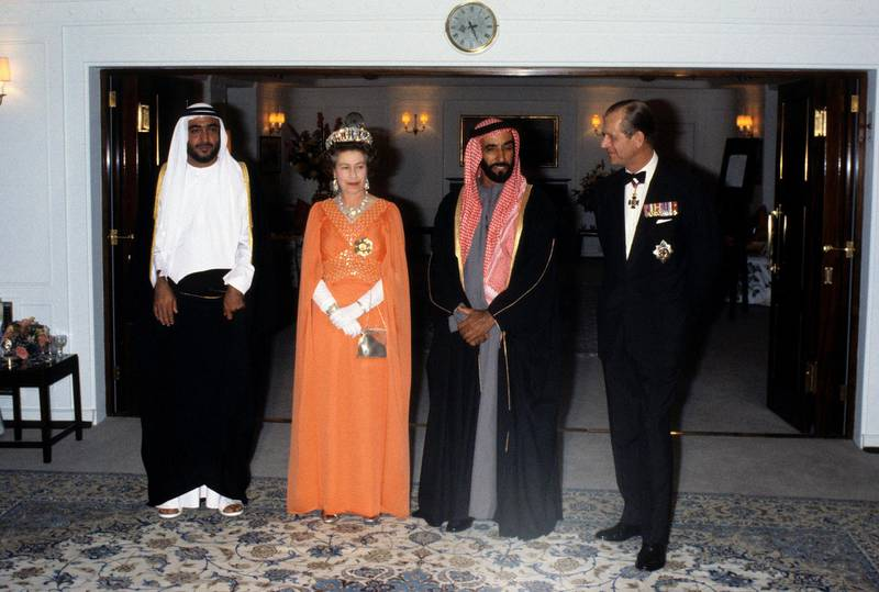 ABU DHABI, UNITED ARAB EMIRATES - FEBRUARY 25:  Queen Elizabeth ll and Prince Philip, Duke of Edinburgh entertain Sheikh Zayed of Abu Dhabi on board the Royal Yacht Britannia during a State Visit to the Gulf States on February 25, 1979 in the United Arab Emirates. (Photo by Anwar Hussein/Getty Images)