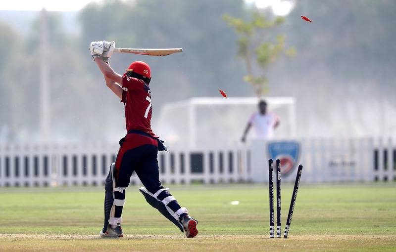 ABU DHABI , UNITED ARAB EMIRATES , October 22  – 2019 :- Harrison Carlyon of Jersey bowled out by Waheed Ahmed during the World Cup T20 Qualifiers between UAE vs Jersey held at Tolerance Oval cricket ground in Abu Dhabi.  ( Pawan Singh / The National )  For Sports. Story by Paul