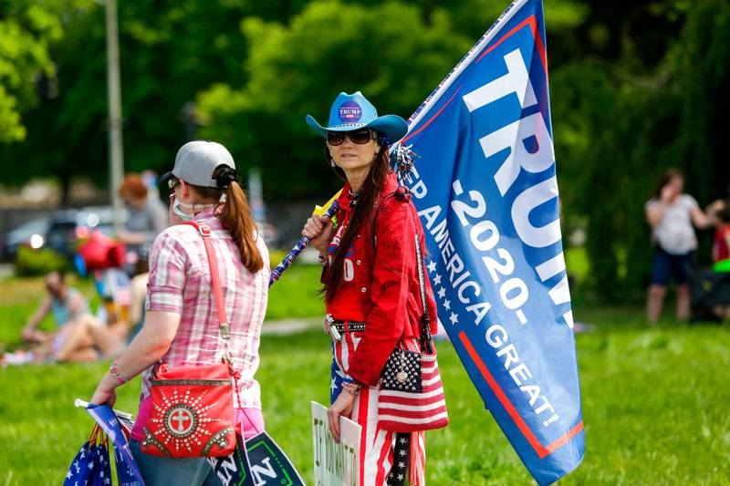 A Trump supporter protests Governor Jay Inslee's stay-at-home order outside the State Capitol in Olympia, Washington on May 9, 2020. The Washington State Patrol estimates about 1,500 people rallied against Governor Jay Inslee's stay-at-home order. / AFP / Jason Redmond