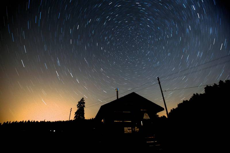 epaselect epa06928342 A long exposure image shows Stars revolving around the North Star during a 'Night of falling stars' on the Col de la Givrine (Givrine Pass), near Saint-Cergue, Switzerland, early 05 August 2018. Astronomers expect the peak of this year's Perseids meteor shower between the 11th and 13th of August although the Perseids usually can be seen in a clear night sky between mid-July and mid-August when particles and debris of its cloud interact with or burn in the earth's atmosphere.  EPA/SALVATORE DI NOLFI
