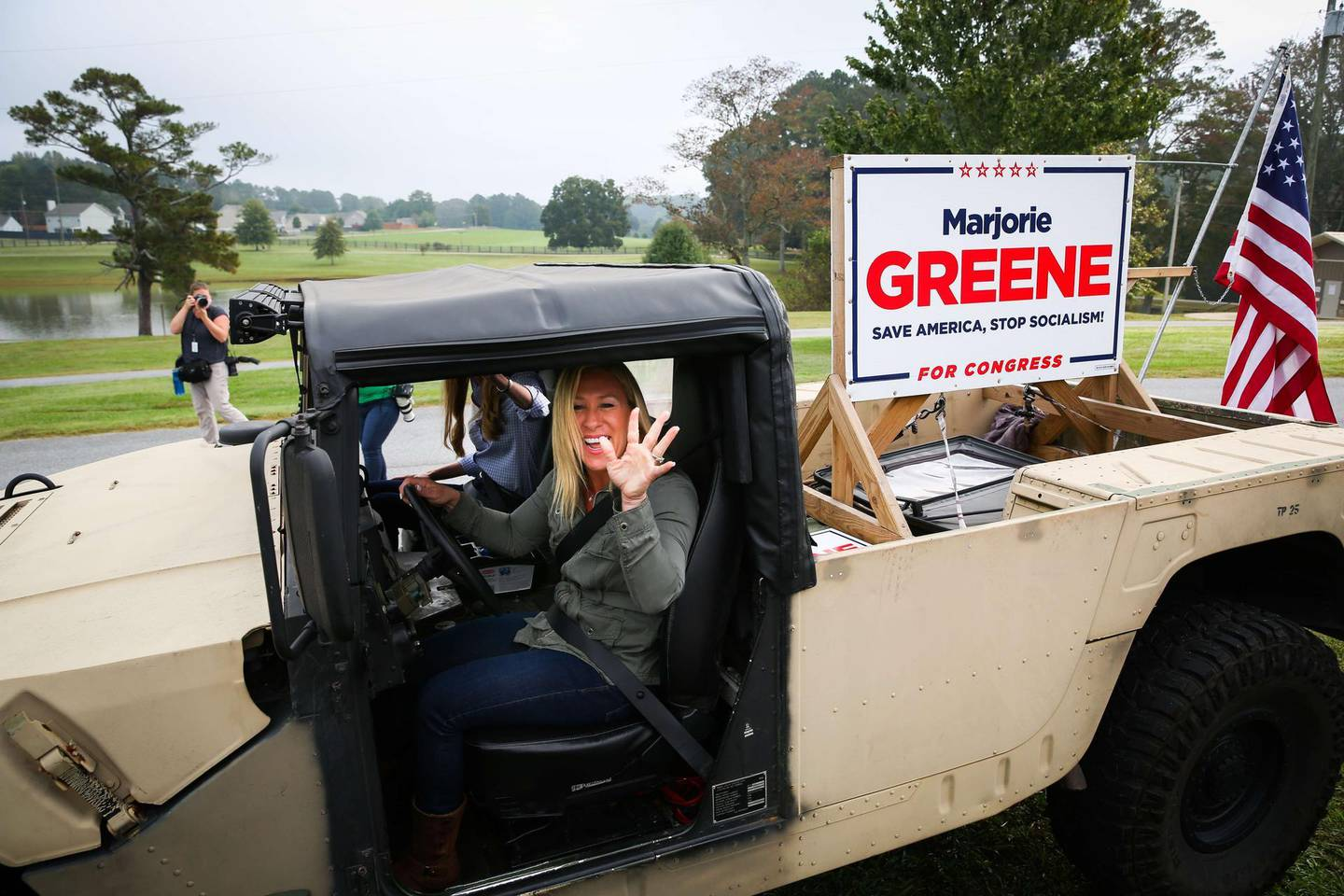DALLAS, GA - OCTOBER 15: Georgia Republican House candidate Marjorie Taylor Greene and Sen. Kelly Loeffler (R-GA) leave a press conference in a Humvee during which Greene endorsed Loeffler on October 15, 2020 in Dallas, Georgia. Greene has been the subject of some controversy recently due to her support for the right-wing conspiracy group QAnon.   Dustin Chambers/Getty Images/AFP == FOR NEWSPAPERS, INTERNET, TELCOS & TELEVISION USE ONLY ==