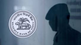 India's reserve bank holds interest rates steady amid recovery optimism