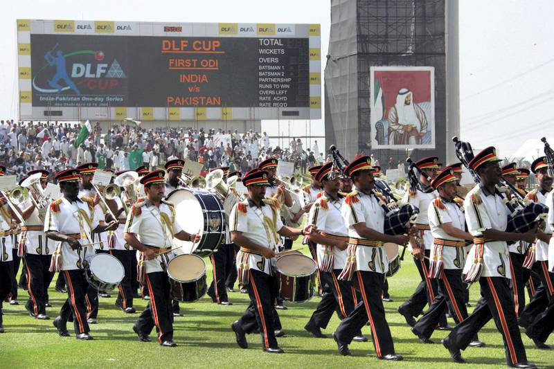 Emirati honour guards perform prior to the opening of the first of two day-night Cricket matches between India and Pakistan at the Zayad Cricket Stadium in Abu Dhabi, 18 April 2006. Proceeds from today's match will be donated to the survivors of the massive earthquake that hit Kashmir last October killing more than 73,000 people in Pakistan and 1,300 in India, while revenues from the second game tomorrow will be shared by the Indian and Pakistan cricket boards. AFP Photo/RABIH MOGHRABI / AFP PHOTO / RABIH MOGHRABI