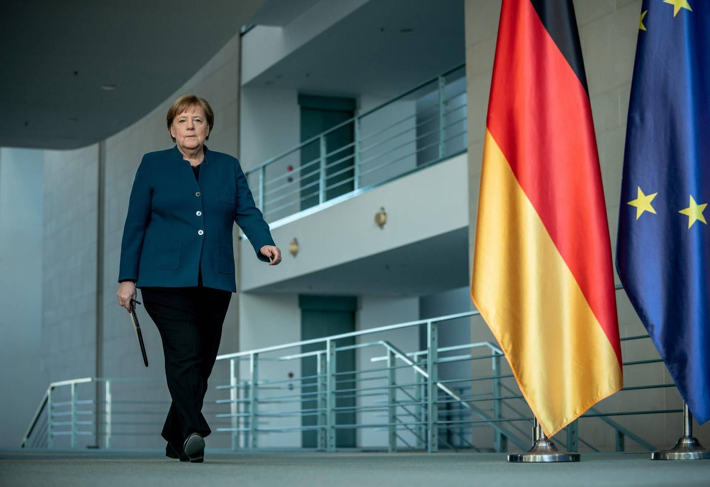 FILE PHOTO: German Chancellor Angela Merkel arrives for a media statement on the spread of the new coronavirus disease (COVID-19) at the Chancellery in Berlin, Germany, March 22, 2020.   Michel Kappeler/Pool via REUTERS/File Photo