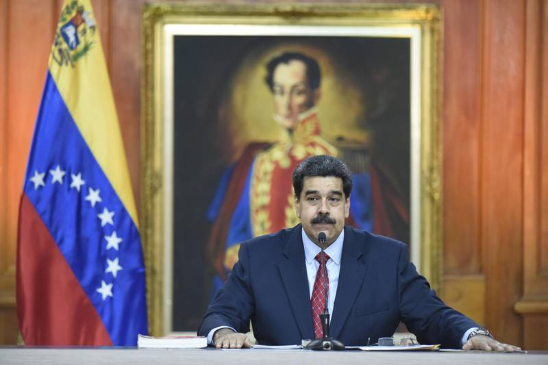 Nicolas Maduro, Venezuela's president, pauses while speaking during a televised press conference in Caracas, Venezuela, on Friday, Jan. 25, 2019. Maduro, speaking from the presidential palace in front of press, military and government officials, broadcast his comments across all radio and television airwaves and channels, showcasing his total control over the state apparatus despite Guaido's claims to legitimacy. Photographer: Carlos Becerra/Bloomberg