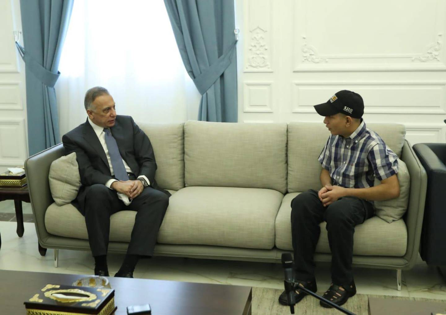 Iraqi Prime Minister Mustafa al-Kadhimi meets with Iraqi teenager Hamid Saeed, who was mistreated by members of security forces, after he was released from jail in Baghdad, Iraq August 3, 2020. Picture taken August 3, 2020.  Iraqi Prime Minister Media Office/Handout via REUTERS ATTENTION EDITORS - THIS IMAGE WAS PROVIDED BY A THIRD PARTY.