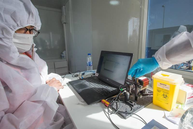 Dubai, United Arab Emirates -Medical staff processing  blood sample at the new DPI Testing Centres border of Dubai and Abu Dhabi.  Leslie Pableo for The National for Shireena Al Nowais story