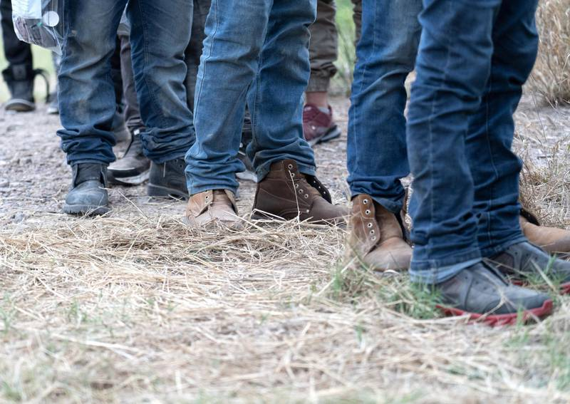 US Border Patrol takes the shoelaces from migrants after they are apprehended. Willy Lowry/ The National
