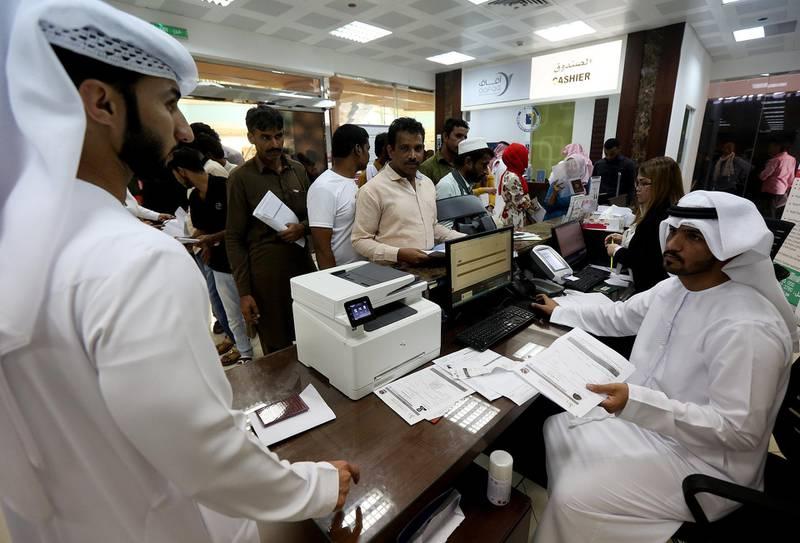 Abu Dhabi, September, 25, 2018: Amnesty seekers  at the Tasheel centre at Al Raha Mall in Abu Dhabi. Satish Kumar for the National/ Story by Haneen Dajani