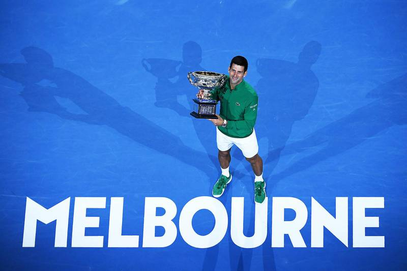 MELBOURNE, AUSTRALIA - FEBRUARY 02: Novak Djokovic of Serbia poses with the Norman Brookes Challenge Cup after winning the Men's Singles Final against Dominic Thiem of Austria on day fourteen of the 2020 Australian Open at Melbourne Park on February 02, 2020 in Melbourne, Australia. (Photo by Hannah Peters/Getty Images)
