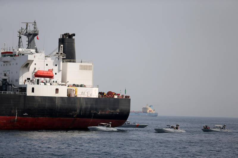 FILE PHOTO: UAE Navy boats are seen next to the Saudi tanker Al Marzoqah off the Port of Fujairah, UAE, May 13, 2019.REUTERS/Satish Kumar/File Photo