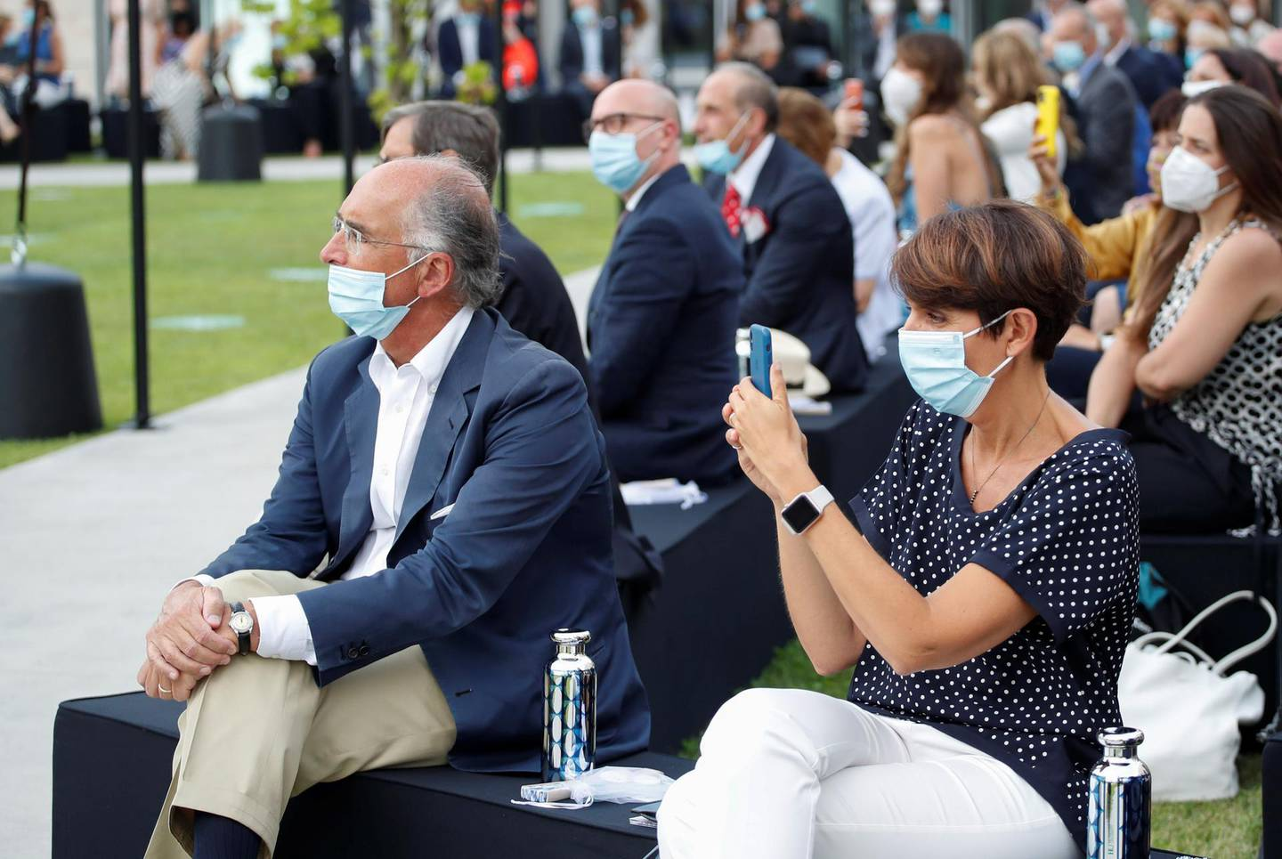 People wearing protective face masks attend the Dolce & Gabbana Spring/Summer 2021 men's collection in a live-streamed show at the university campus of the Humanitas Research Foundation in one of the first physical fashion shows since the coronavirus disease (COVID-19) outbreak, during Milan Digital Fashion Week in Rozzano, south of Milan, Italy, July 15, 2020. REUTERS/Alessandro Garofalo