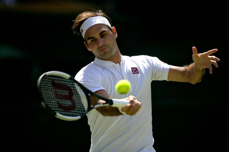 Roger Federer of Switzerland returns the ball to Serbia's Dusan Lajovic during their Men's Singles first round match at the Wimbledon Tennis Championships in London, Monday July 2, 2018. (AP Photo/Tim Ireland)
