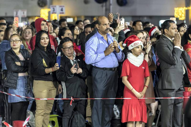 DUBAI, UNITED ARAB EMIRATES. 25 DECEMBER 2019. Midnight Mass at St Mary's in Dubai to celebrate Christmas. Members of the public and family members wait orderly for the ceremony to start. (Photo: Antonie Robertson/The National) Journalist: None. Section: National.