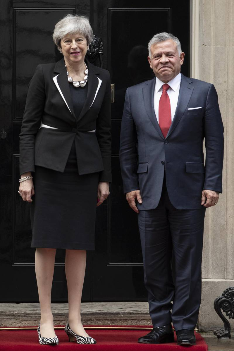 LONDON, ENGLAND - FEBRUARY 28: British Prime Minister, Theresa May greets King Abdullah II of Jordan outside number 10 Downing Street on February 28, 2019 in London, England. King Abdullah II and his wife Queen Rania, met with Britain's Queen Elizabeth II, during a private audience at Buckingham Palace this morning. (Photo by Dan Kitwood/Getty Images)