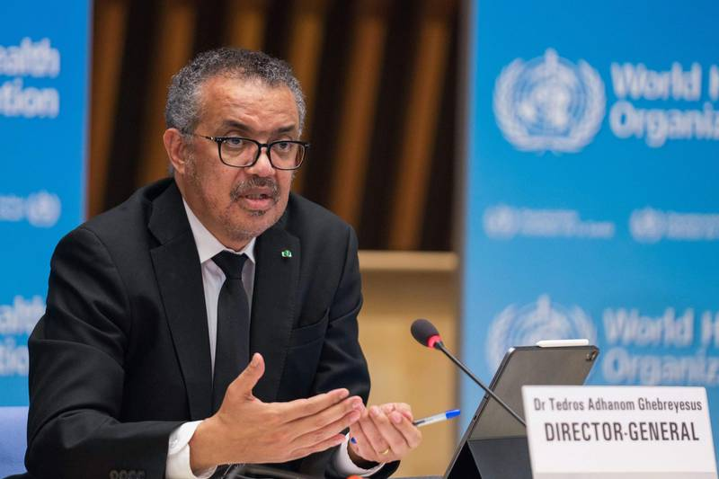 """This handout picture taken and released on February 12, 2021 by World Health Organization (WHO) shows  WHO Director-General Tedros Adhanom Ghebreyesus delivering remarks during a press conference on February 12, 2021 in Geneva. The head of the World Health Organization said on February 12, 2021 that all hypotheses on the origins of the Covid-19 pandemic remained on the table following the WHO's investigation in China. - RESTRICTED TO EDITORIAL USE - MANDATORY CREDIT """"AFP PHOTO/ CHRIS BLACK/ WORLD HEALTH ORGANIZATION"""" - NO MARKETING - NO ADVERTISING CAMPAIGNS - DISTRIBUTED AS A SERVICE TO CLIENTS  / AFP / World Health Organization / Christopher Black / RESTRICTED TO EDITORIAL USE - MANDATORY CREDIT """"AFP PHOTO/ CHRIS BLACK/ WORLD HEALTH ORGANIZATION"""" - NO MARKETING - NO ADVERTISING CAMPAIGNS - DISTRIBUTED AS A SERVICE TO CLIENTS"""