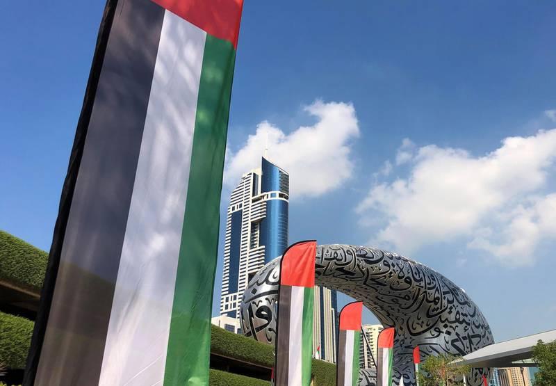Dubai, United Arab Emirates - November 30, 2020: National Day. UAE flags outside the Museum of the Future. Monday, November 30th, 2020 in Dubai. Chris Whiteoak / The National