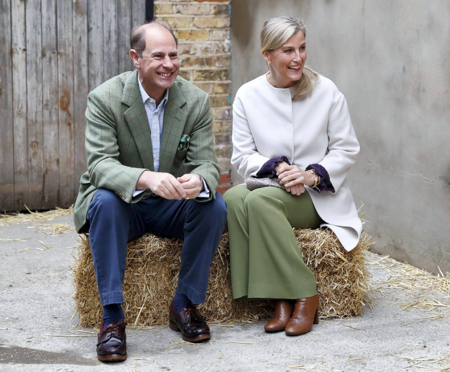LONDON, UNITED KINGDOM - OCTOBER 01: (EMBARGOED FOR PUBLICATION IN UK NEWSPAPERS UNTIL 24 HOURS AFTER CREATE DATE AND TIME) Prince Edward, Earl of Wessex and Sophie, Countess of Wessex sit on a hay bale during a visit to Vauxhall City Farm on October 1, 2020 in London, England. Their Royal Highnesses visit is to see the farm's community engagement and education programmes in action, as the farm marks the start of Black History Month. (Photo by Max Mumby/Indigo/Getty Images)