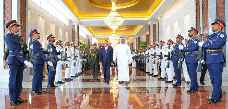 """A handout picture provided by the Egyptian Presidency shows Abu Dhabi Crown Prince and Deputy Supreme Commander of the UAE Armed Forces Mohammed bin Zayed al-Nahyan (C-R) bidding farewell to Egyptian President Abdel Fattah al-Sisi following their meeting in Abu Dhabi on May 4, 2017. (Photo by HO / EGYPTIAN PRESIDENCY / AFP) / RESTRICTED TO EDITORIAL USE - MANDATORY CREDIT """"AFP PHOTO / EGYPTIAN PRESIDENCY - NO MARKETING NO ADVERTISING CAMPAIGNS - DISTRIBUTED AS A SERVICE TO CLIENTS"""