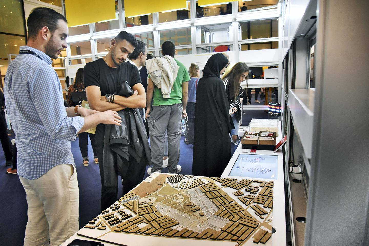 An exhibitor, left, explains his project at the Global Grad Show during the Dubai Design Week at the Dubai Design District, Dubai, UAE, on Monday, Nov. 11, 2019. (Photos by Shruti Jain - The National)