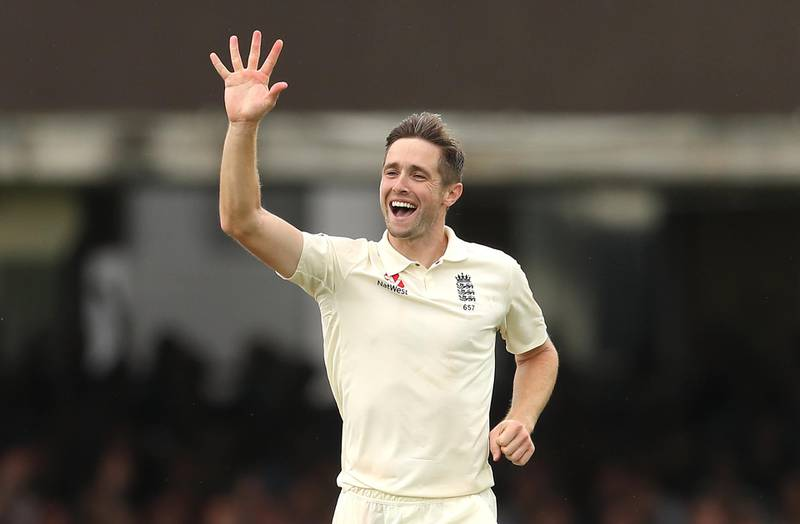 England's Chris Woakes (centre) celebrates the catch of Ireland' Stuart Thompson and his fifth wicket of the day during day three of the Specsavers Test Series match at Lord's, London. PRESS ASSOCIATION Photo. Picture date: Friday July 26, 2019. See PA story CRICKET England. Photo credit should read: Bradley Collyer/PA Wire. RESTRICTIONS: Editorial use only. No commercial use without prior written consent of the ECB. Still image use only. No moving images to emulate broadcast. No removing or obscuring of sponsor logos.