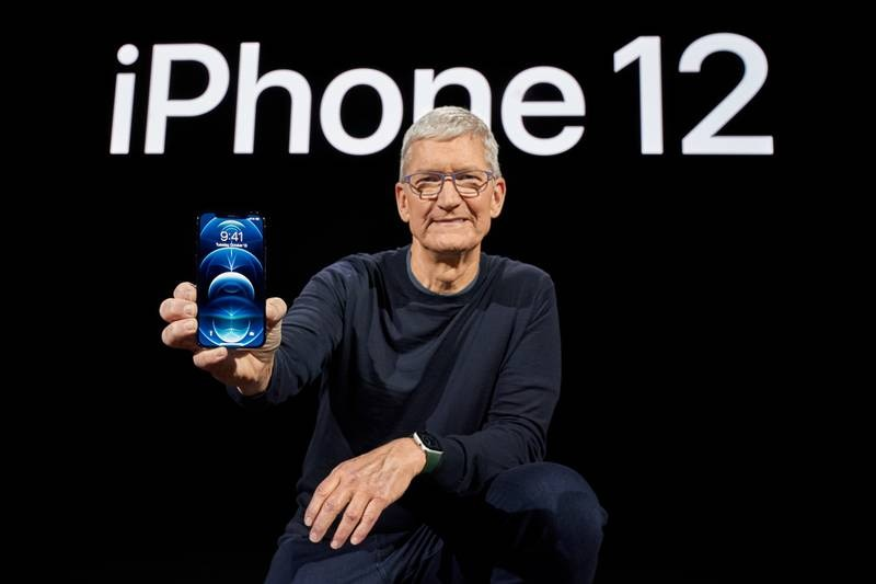 epa08741384 Handout image released by Apple showing Apple CEO Tim Cook showcasing the all-new iPhone 12 Pro during a special event at Apple Park in Cupertino, California, USA, 13 October 2020. Apple is expected to introduce several new products including a new iPhone.  EPA/BROOKS KRAFT / APPLE INC. / HO EDITORIAL USE ONLY, NO SALES