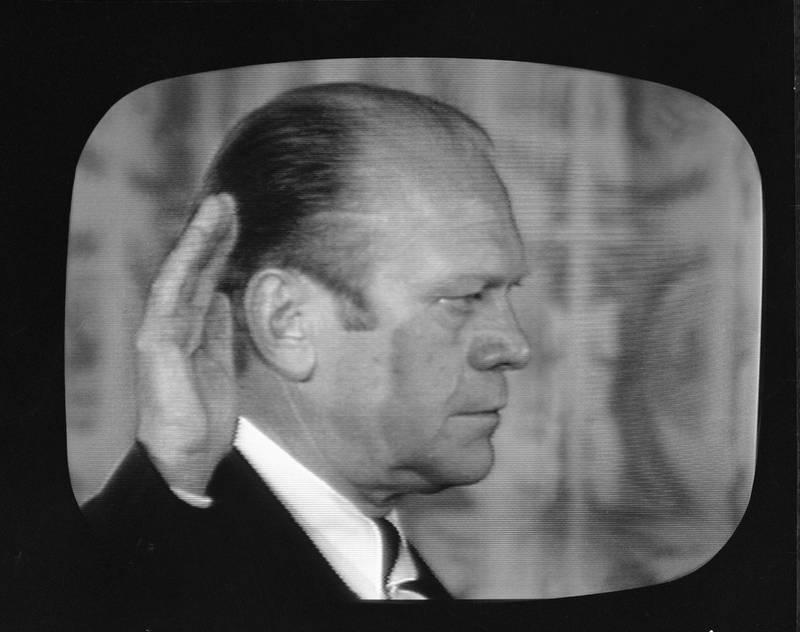 Screen capture shows American politician Gerald Ford with his right hand raised as he is sworn in as the 38th president of the United States, East Room, White House, Washington, DC, August 9, 1974. Ford replaced Richard Nixon who resigned to avoid a potential impeachment. (Photo by CBS Photo Archive/Getty Images)