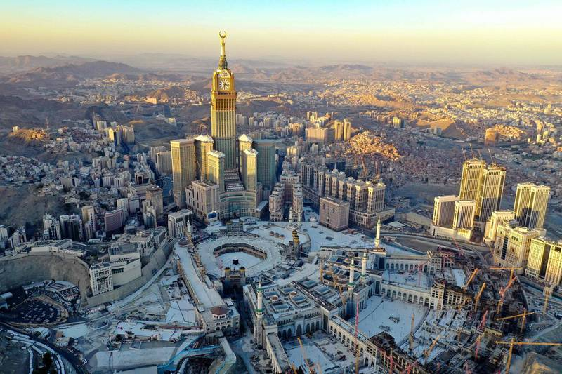An aerial view shows the Great Mosque and the Mecca Tower in a deserted surrounding on the first day of the Muslim fasting month of Ramdan, in the Saudi holy city of Mecca, on April 24, 2020, during the novel coronavirus pandemic crisis. / AFP / BANDAR ALDANDANI