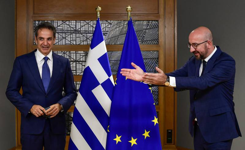 European Council President Charles Michel gestures as he greets Greek Prime Minister Kyriakos Mitsotakis ahead of the second face-to-face European Union summit since the coronavirus disease (COVID-19) outbreak, in Brussels, Belgium October 1, 2020. John Thys/Pool via REUTERS