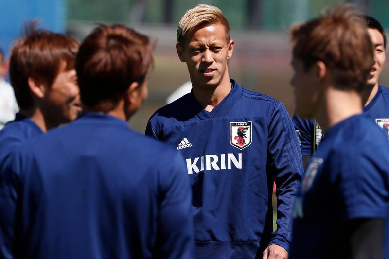 epa06814934 Japan's midfielder Keisuke Honda (C) attends a training session at the FC Rubin training ground sports base in Kazan, Russian Federation, 17 June 2018. Japan will face Colombia in the FIFA World Cup 2018 Group H preliminary round soccer match on 19 June 2018.  EPA/DIEGO AZUBEL