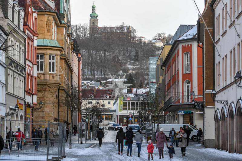 """People walk through the city centre of Amberg, southern Germany, on January 2, 2019. A German far-right group has launched a vigilante street patrol in a Bavarian town where four Afghan and Iranian asylum seekers allegedly attacked passers-by last weekend. The mayor of Amberg, Michael Cerny, said he was """"shocked"""" after the extremist NPD party posted photos online of four people wearing red protective vests to create """"safe spaces"""", including outside a refugee centre.  - Germany OUT  / AFP / dpa / Armin Weigel"""