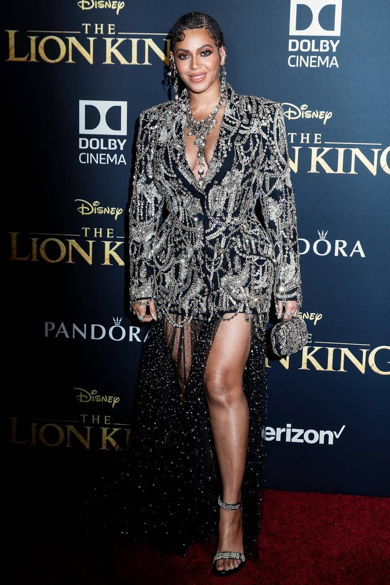 epa07706634 US singer Beyonce poses for photographers on the red carpet prior to the world premiere of 'The Lion King' at the Dolby Theater in Hollywood, California, USA, 09 July 2019. The film will be released in US theaters on 19 July.  EPA-EFE/ETIENNE LAURENT