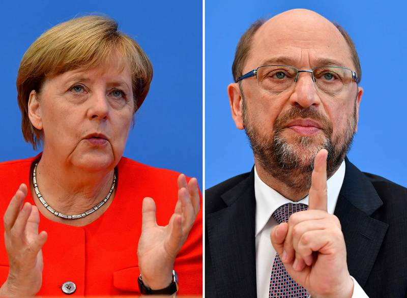 (COMBO) This combination created on September 1, 2017 of file pictures shows German Chancellor Angela Merkel, also leader of the conservative Christian Democratic Union (CDU) party (L, on August 29, 2017 in Berlin) and Martin Schulz, leader of Germany's social democratic SPD party and candidate for Chancellor (June 27, 2017 in Berlin). Angela Merkel, Germany's cool and collected chancellor, will go head-to-head Sunday, September 3, 2017, with her fiery challenger Martin Schulz in their only television debate before this month's general elections, in a crucial match that could sway millions of voters. / AFP PHOTO / Tobias SCHWARZ