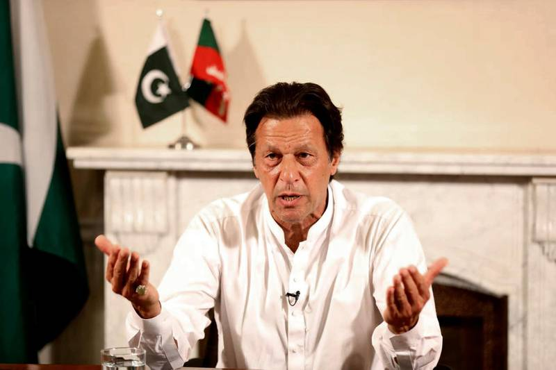 """In this photo provided by the office of Pakistan Tehreek-e-Insaf party, Pakistani politician Imran Khan, chief of Pakistan Tehreek-e-Insaf party, delivers his address in Islamabad, Pakistan, Thursday, July 26, 2018. Khan declared victory Thursday for his party in the country's general elections, promising a """"new"""" Pakistan following a vote that was marred by allegations of fraud and militant violence. (Tehreek-e-Insaf via AP)"""